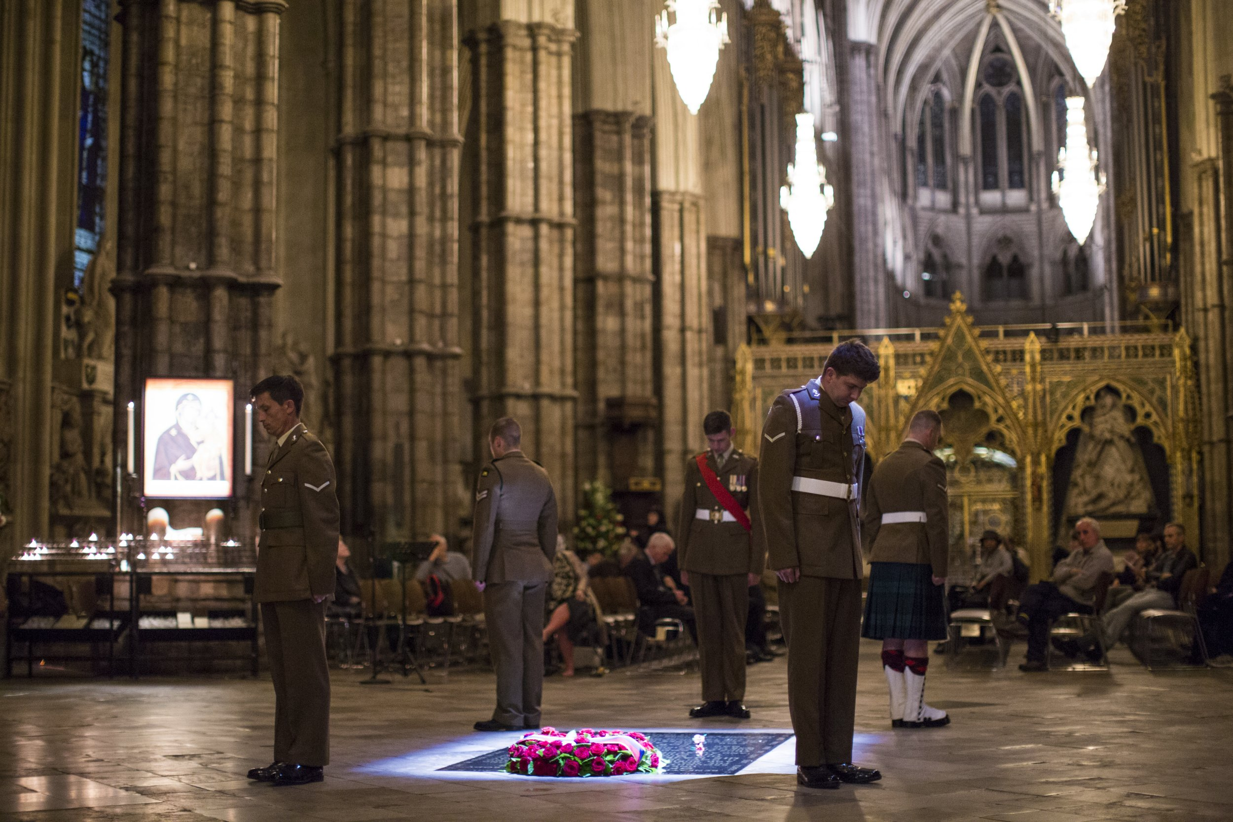 LONDON, ENGLAND - JULY 01: British Military personnel LBdr Walsh, LCpl Drury, LCpl Kinmond, Cpl Wolfe and Sgt Cohoon stand at the Grave of the Unknown Warrior during a vigil to commemorate the centenary of the Battle of the Somme at Westminster Abbey on July 1, 2016 in London, England. The overnight vigil is being held to remember those who died in the Battle of the Somme which began 100 years ago on July 1st 1916. Armies of British and French soldiers fought against the German Empire and over one million lives were lost. The Grave of the Unknown Warrior contains the body of an unidentified British solider from the First World War buried in French soil and covered with a Belgian marble slab. (Photo by Jack Taylor/Getty Images)
