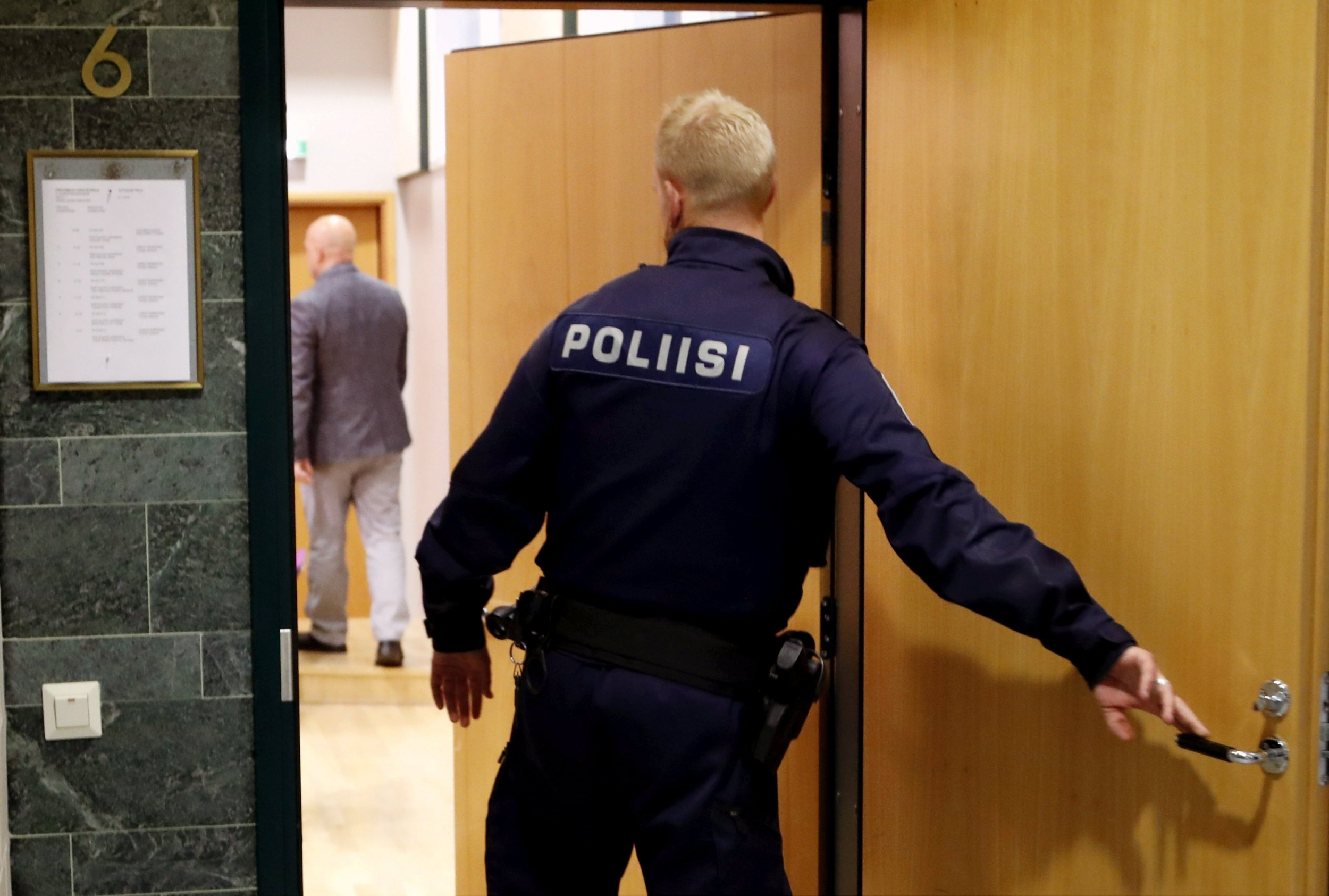 A police officer is photographed at the Pirkanmaa district court where a hearing for the case of six Cuban volleyball players suspected of an aggravated rape takes place in Tampere, Finland July 5th 2016. The suspected felony is said to have taken place in the night between 2nd and 3rd of July in Tampere. Lehtikuva/Kalle Parkkinen/via REUTERS    ATTENTION EDITORS - THIS IMAGE WAS PROVIDED BY A THIRD PARTY. FOR EDITORIAL USE ONLY. NO THIRD PARTY SALES. NOT FOR USE BY REUTERS THIRD PARTY DISTRIBUTORS. FINLAND OUT. NO COMMERCIAL OR EDITORIAL SALES IN FINLAND.