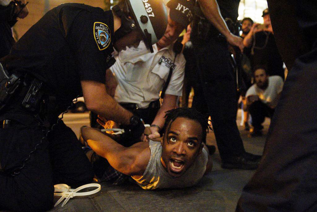A protester is detained by NYPD officers as people take part in a protest against the killings of Alton Sterling and Philando Castile during a march through Manhattan in New York July 7, 2016. REUTERS/Darren Ornitz TPX IMAGES OF THE DAY