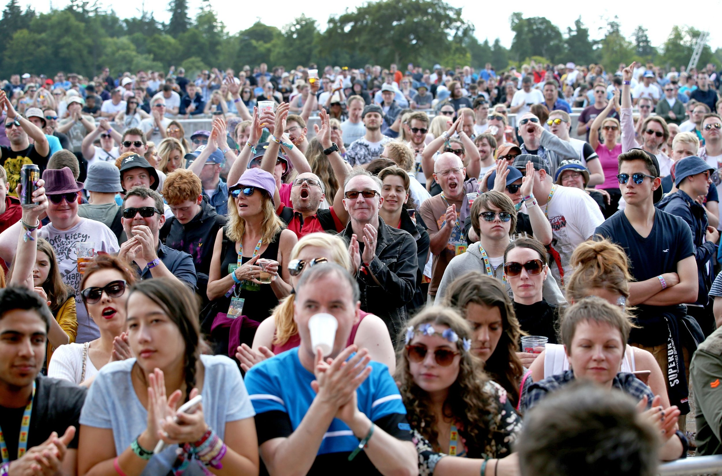 Festivalgoers watch the Fun Lovin' Criminals, on the main stage at T in the Park, the annual music festival held at Strathallan Castle, Perthshire. PRESS ASSOCIATION Photo. Picture date: Friday July 8, 2016. See PA story SHOWBIZ Festival. Photo credit should read: Jane Barlow/PA Wire