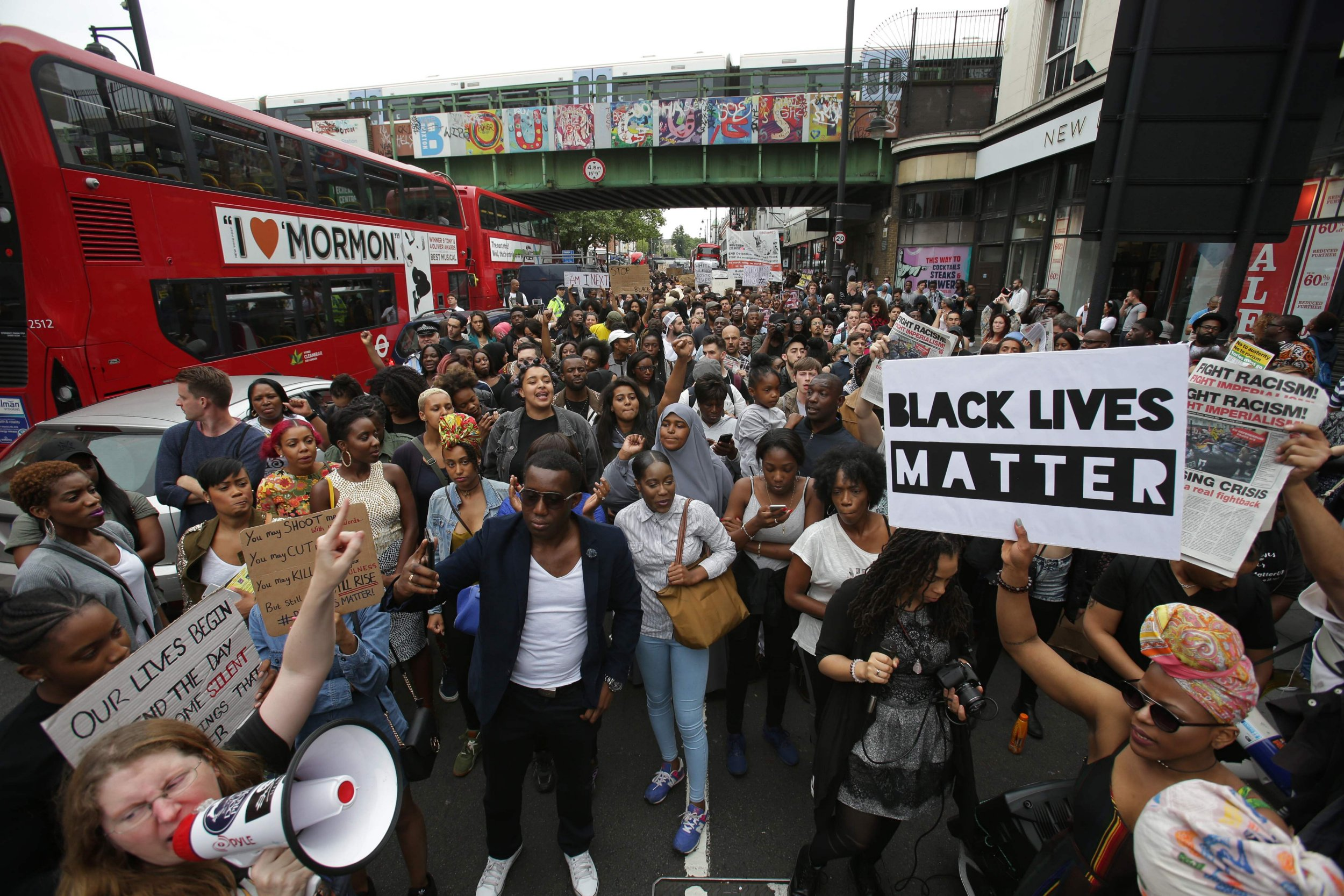People chant as they march with placards in Brixton, south London to protest against police brutality in the US, on July 9, 2016, after two recent incidents where black men have been shot and killed by police officers. / AFP PHOTO / Daniel Leal-OlivasDANIEL LEAL-OLIVAS/AFP/Getty Images