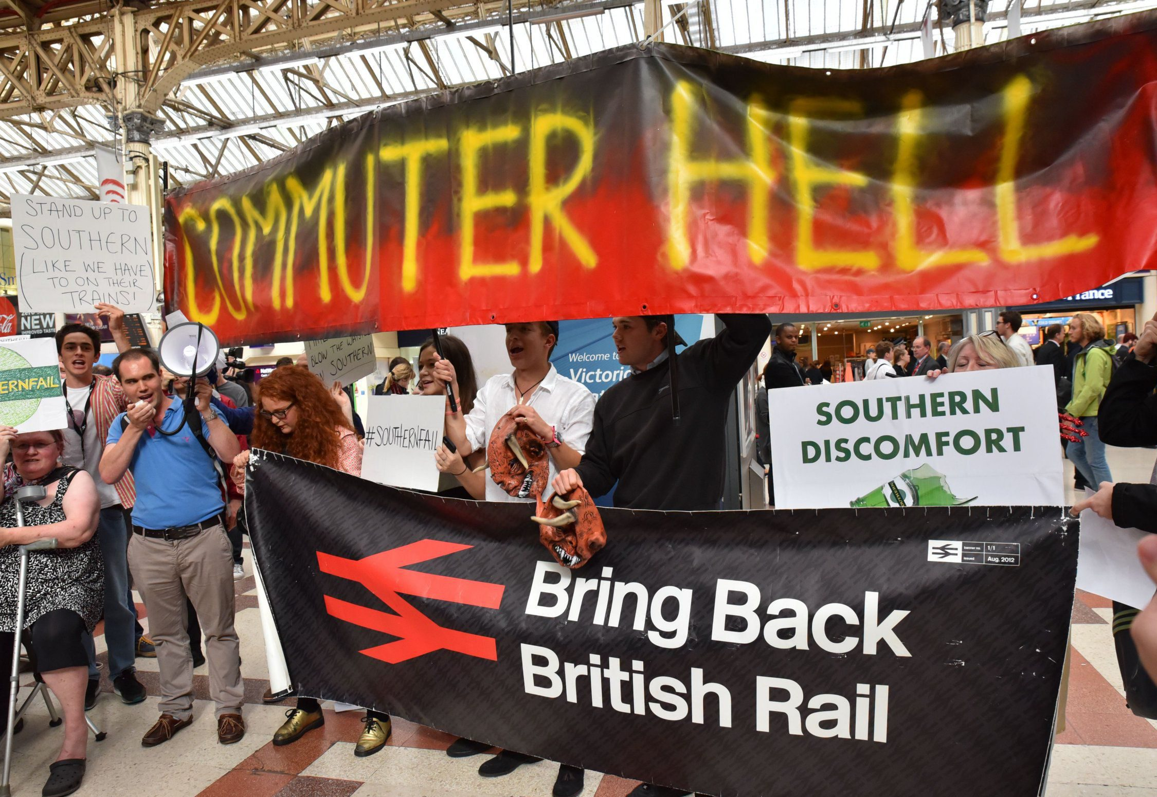Mandatory Credit: Photo by Matthew Chattle/REX/Shutterstock (5754963c) Commuters protest in Victoria Station against the poor service and cancellations on Southern Rail. Southern Rail protest in Victoria Station, London, UK - 11 Jul 2016