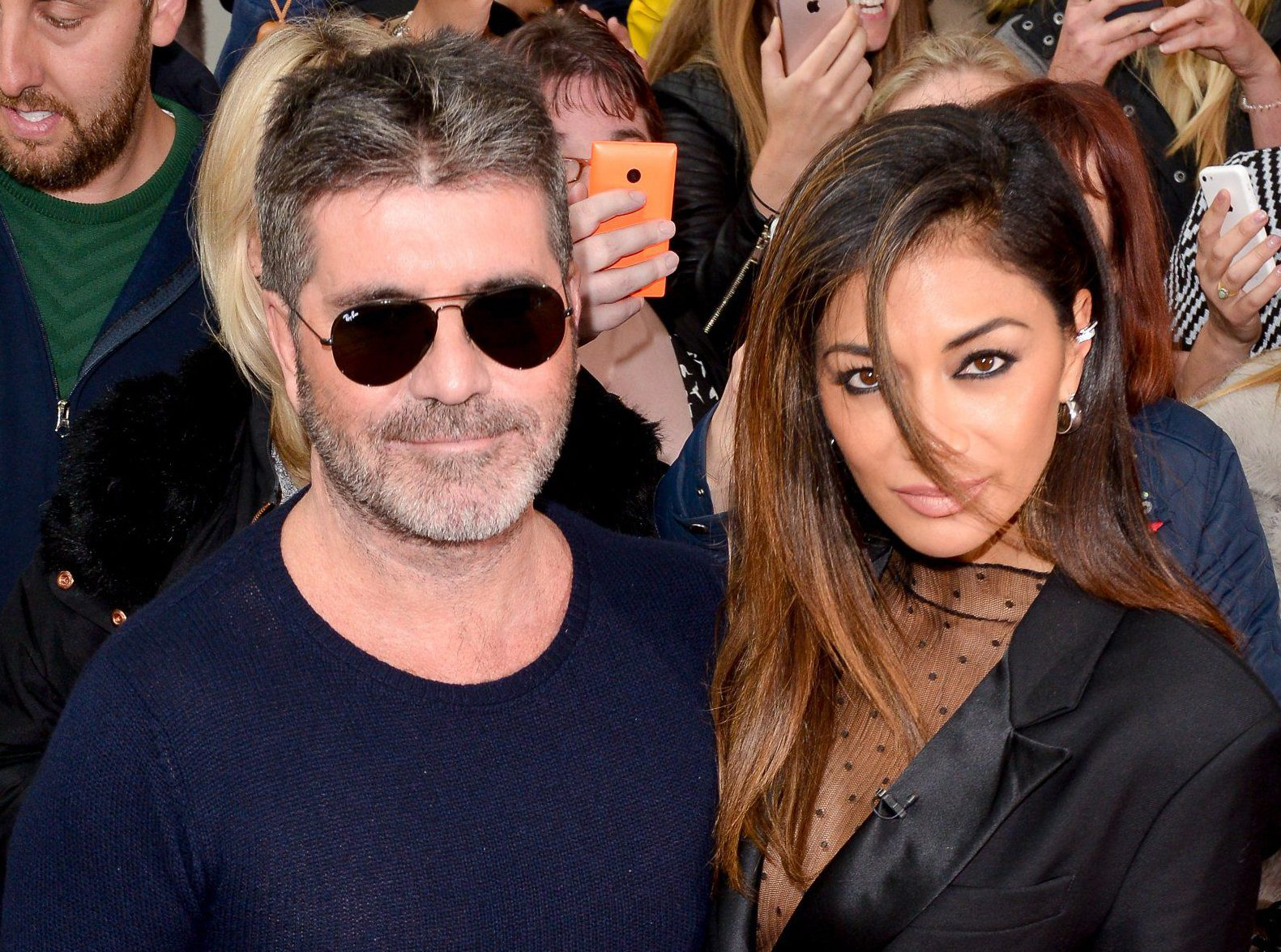 MANCHESTER, ENGLAND - JUNE 13: Simon Cowell with Nicole Scherzinger as they arrive for the X Factor Auditions Manchester at Old Trafford on June 13, 2016 in Manchester, England. (Photo by Richard Stonehouse/Getty Images)
