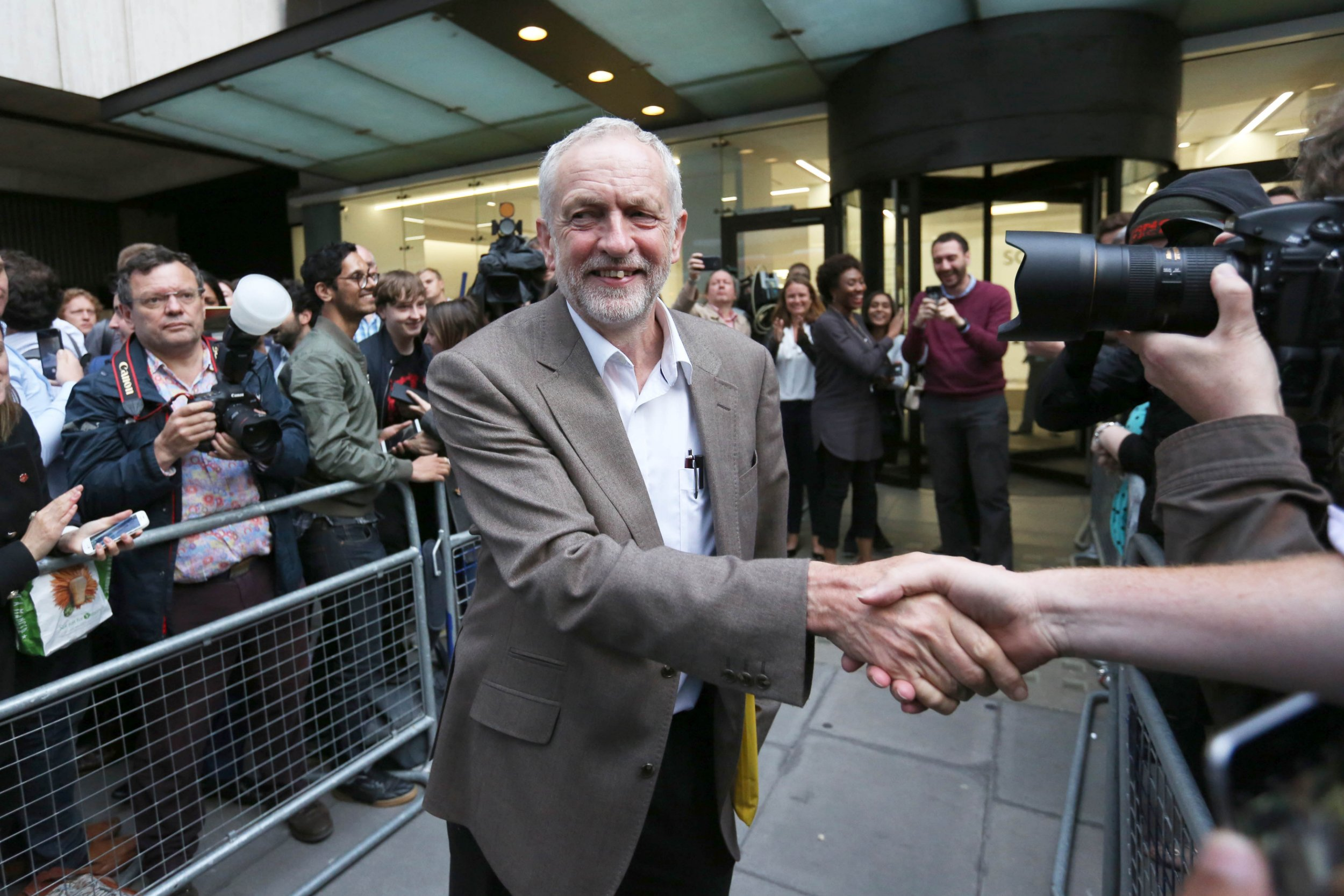 """Labour Party leader Jeremy Corbyn leaves Labour HQ in Westminster, London, where the Labour NEC held meeting about the party leadership contest, as Corbyn has said that Labour MPs will understand they have to come together after it was agreed to automatically include him on the ballot in the party's leadership contest. PRESS ASSOCIATION Photo. Picture date: Tuesday July 12, 2016. The Opposition leader said he was """"delighted"""" that the secret vote of the ruling National Executive Committee went in his favour after hours of discussions at the party's headquarters in central London. See PA story POLITICS Labour. Photo credit should read: Rick Findler/PA Wire"""