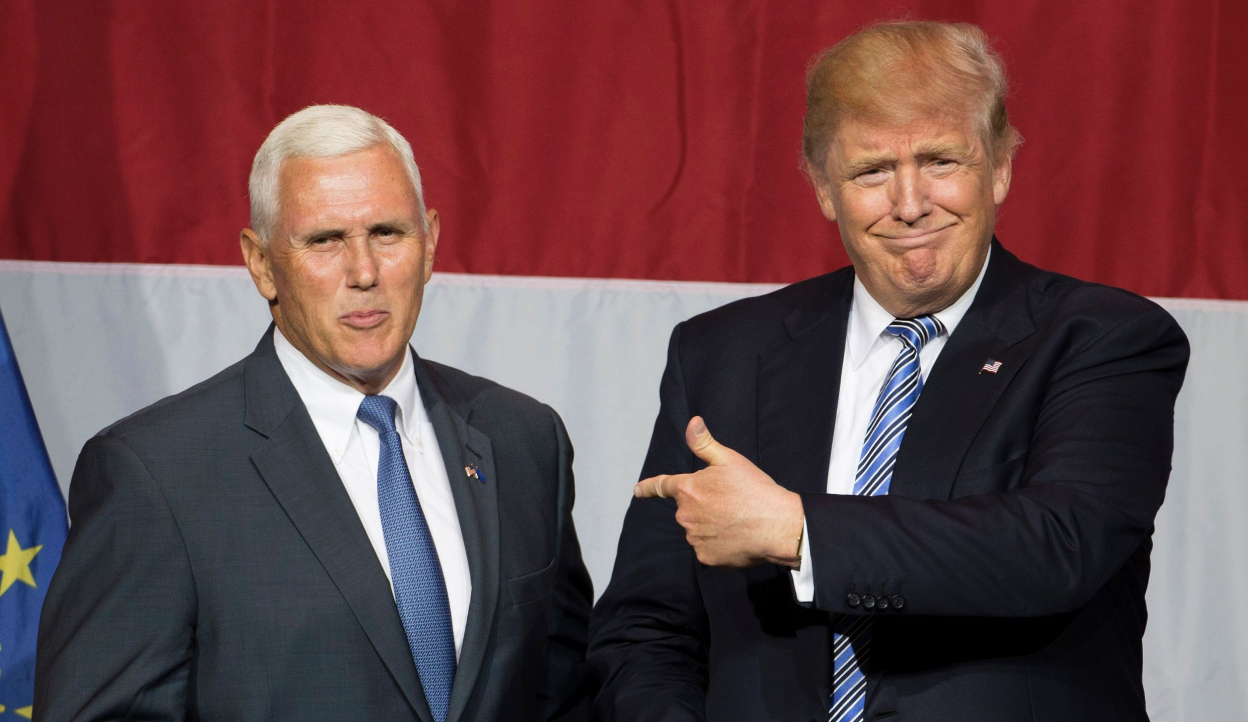 (FILES) This file photo taken on July 12, 2016 shows US Republican presidential candidate Donald Trump (R) and Indiana Governor Mike Pence (L) taking the stage during a campaign rally at Grant Park Event Center in Westfield, Indiana. Trump named Pence as his vice presidential running mate, on July 15, 2016. / AFP PHOTO / Tasos KATOPODISTASOS KATOPODIS/AFP/Getty Images
