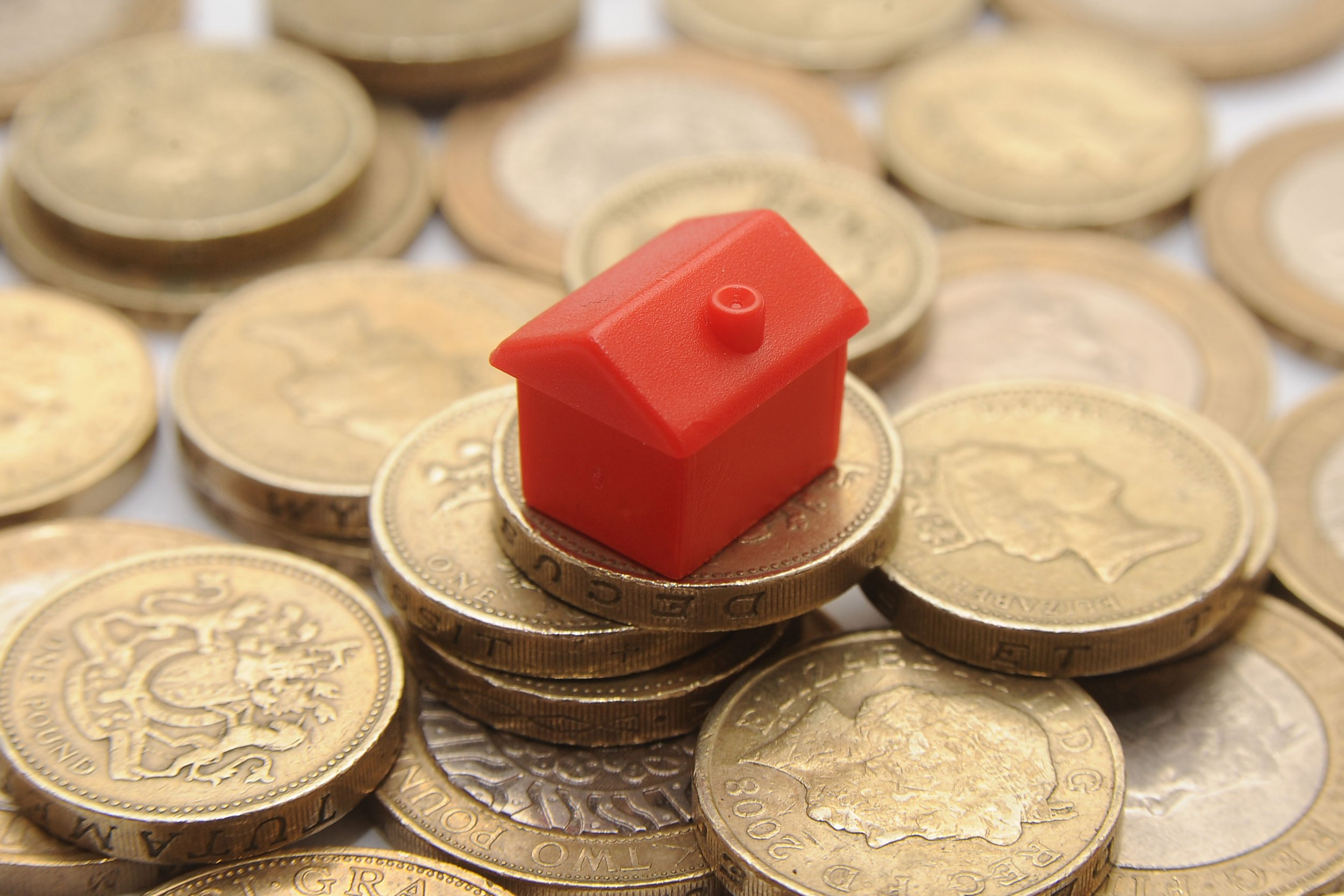 File photo dated 27/01/15 of a plastic model of a house on a pile of one pound coins. Millennials face paying £44,000 more on rent typically by the time they turn 30 than the baby boomer generation, analysis from a think-tank has found. PRESS ASSOCIATION Photo. Issue date: Saturday July 16, 2016. The Resolution Foundation said a combination of falling home ownership levels among the younger generation and rising costs in the private rented sector have fuelled the increase. See PA story MONEY Millennials. Photo credit should read: Joe Giddens/PA Wire