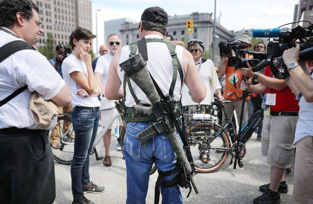 CLEVELAND, OH - JULY 17: A lone member of a group supporting the carrying of weapons openly speaks to the media at what was supposed to be a march ahead of the Republican National Convention on July 17, 2016 in Cleveland, Ohio. An estimated 50,000 people are expected in Cleveland, including hundreds of protesters and members of the media. The four-day Republican National Convention kicks off on July 18. (Photo by Spencer Platt/Getty Images)