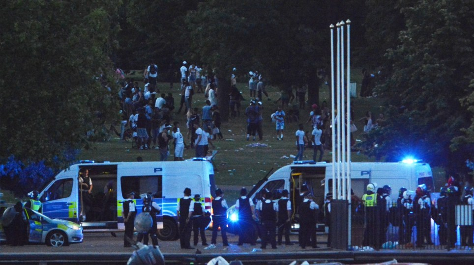 crop- EXCLUSIVE Two police officers have been rushed to hospital after a water fight in London's Hyde Park descended in to violence today. Video footage available on request from Vantage News 19 July 2016. Please byline: Hamilton/Vantagenews.com Photographer: Hamilton/Vantagenews.com