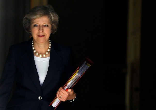 Britain's Prime Minister Theresa May leaves 10 Downing street to attend her first Prime Ministers Questions at the House of Parliament in London, Wednesday, July 20, 2016. øPrime Minister Theresa May is making her first overseas trip as Britainís leader on Wednesday to meet German Chancellor Angela Merkel, a key figure in negotiating Britain's exit from the European Union. (AP Photo/Frank Augstein)