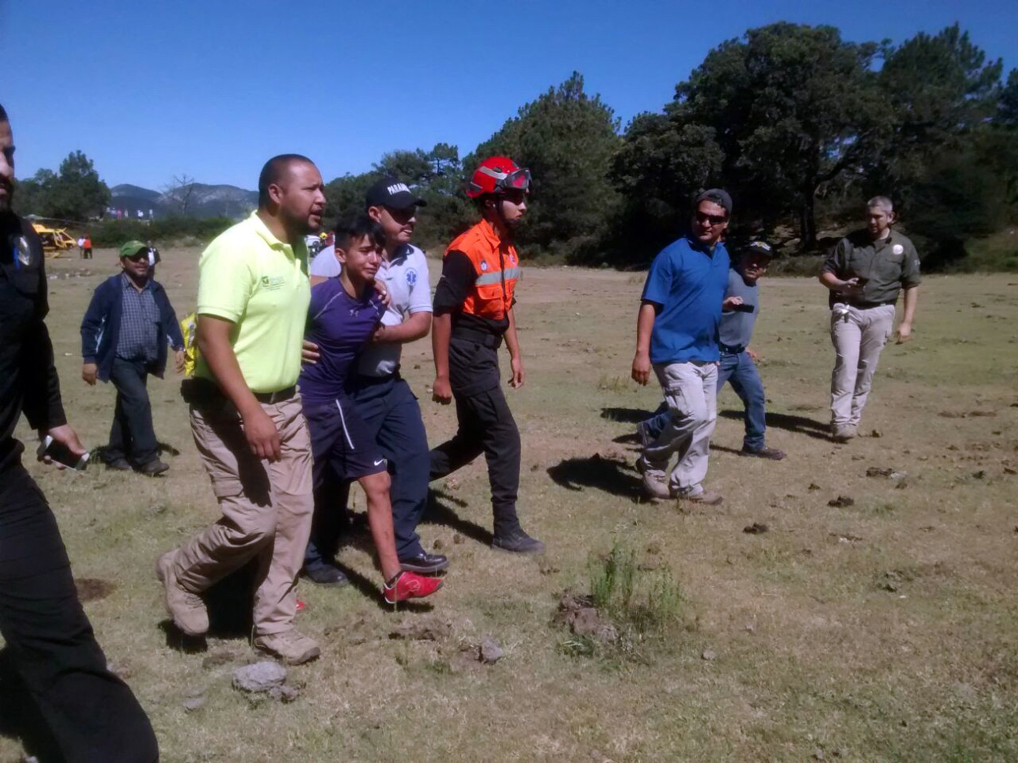 """CEN-Pic shows: Juan Heriberto Trevino leaving the helicopter. A teenage boy scout who got lost during a hike in a perilous mountain range was accompanied during the two days he was lost by a dog who kept him warm at night and then helped him back to civilisation. The 14-year-old, Juan Heriberto Trevino, had been attending a summer camp with his friends in the highlands of the municipality of Galeana, in the north-eastern Mexican state of Nueva Leon. He was walking and left the group searching for logs to make a tent to sleep in that night when he fell down a ravine. He said: """"I slipped down the ravine, I was rolling and held on to a tree to stop my fall. I got down to a river bed, which had no water and walked straight along it looking for the valley."""" He was saved when a Labrador turned up alongside him and never left his side the whole time he was lost. And he explained how realising he had no idea where he was, he had ended up following the dog. Juan said: """"He stayed by my side the whole time, making me feel safe. """"I did not walk at night because I knew I could get more lost, so I put twigs over my legs and hugged the dog to keep warm. """"We came up to a pool of water and I saw that the dog drank from it, and I was so thirsty I drank too. I prayed all the time to God that they would find me."""" For 40 hours the search for Juan continued. And finally in the early hours of the morning two villagers who had joined the search on their horses found him. They describe how he ran up to them with his faithful friend in tow and gave them a hug saying he thought he would never be found. The youth was taken away in the helicopter with the dog to be treated for minor injuries. The dog, later revealed to be called Max, was found to be from a local ranch. Juan wanted to adopt his saviour, although it appears that for the moment he is staying with his current owners. The boy meanwhile is now safe and sound and back with his family. (ends)"""