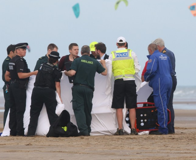 """Rye,East Sussex Sunday 24 July 2016 Three people have got into difficulty at Camber Sands on Sunday afternoon (July 24). Two men have been rescued and one man is still missing after swimming in the sea. Police have been assisting their colleagues from the Coastguard and RNLI to search for the man who is still missing. A call was received around 12.30pm to reports of a man who had disappeared while swimming. While on the beach, two men were found to have gone into cardiac arrest on the beach having got into difficulty in the sea. Both men were given CPR by police officers before ambulance services were on scene. Both men were then flown by helicopter to the William Harvey Hospital in Kent where they remain in a serious but stable condition. Inspector Mark Evans said: """"We are working to establish who these two men are and trace their family and friends. We are continuing to support the coastguard and RNLI as they search for the 19-year-old man from London was. Found. by a. local. Surfing school who raised the alarm. They attempted to give the man CPR. This was than taken over by Coastguard and. Paramedic. Police using a. 4x4 wrapped the.white body bag and. Recovered dit. It on the back of. The. 4x4 to an awaiting. ambulance. """"It seems this has been three people who have got into trouble while swimming with the changing tides and coastline.î The. Two other men who where given CPR have bene placed in induced comas. By hospital staff. ©UKNIP"""
