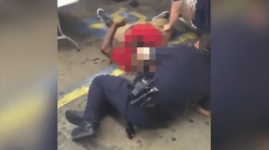 They then took what looks like a gun from his body (Picture: Abdullah Muflahi)