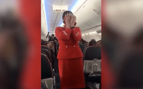 A plane full of rowdy football fans make this air stewardess's job impossible