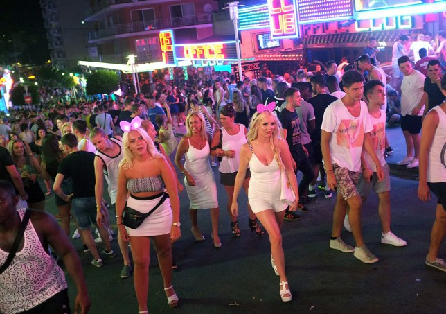 Tourists crowd in Punta Ballena street in Magaluf holiday resort in Calvia on the Spanish Mallorca Island on July 19, 2014. Known among some tourists as Shagaluf, the resort has suffered particularly bad press over the past 12 months after a video showing a Northern Irish teenage girl performing sex acts on a group of men during a bar crawl went viral last summer. It is estimated 1 million Britons visit the region each year, bringing 800 million euros (866 million dollars) to the local economy, but the council is desperate to improve the reputation of destination, reported British journal The Guardian. AFP PHOTO / JAIME REINA (Photo credit should read JAIME REINA/AFP/Getty Images)