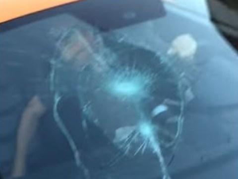 McLaren 'runs stop sign' so kid smashes windscreen with his skateboard