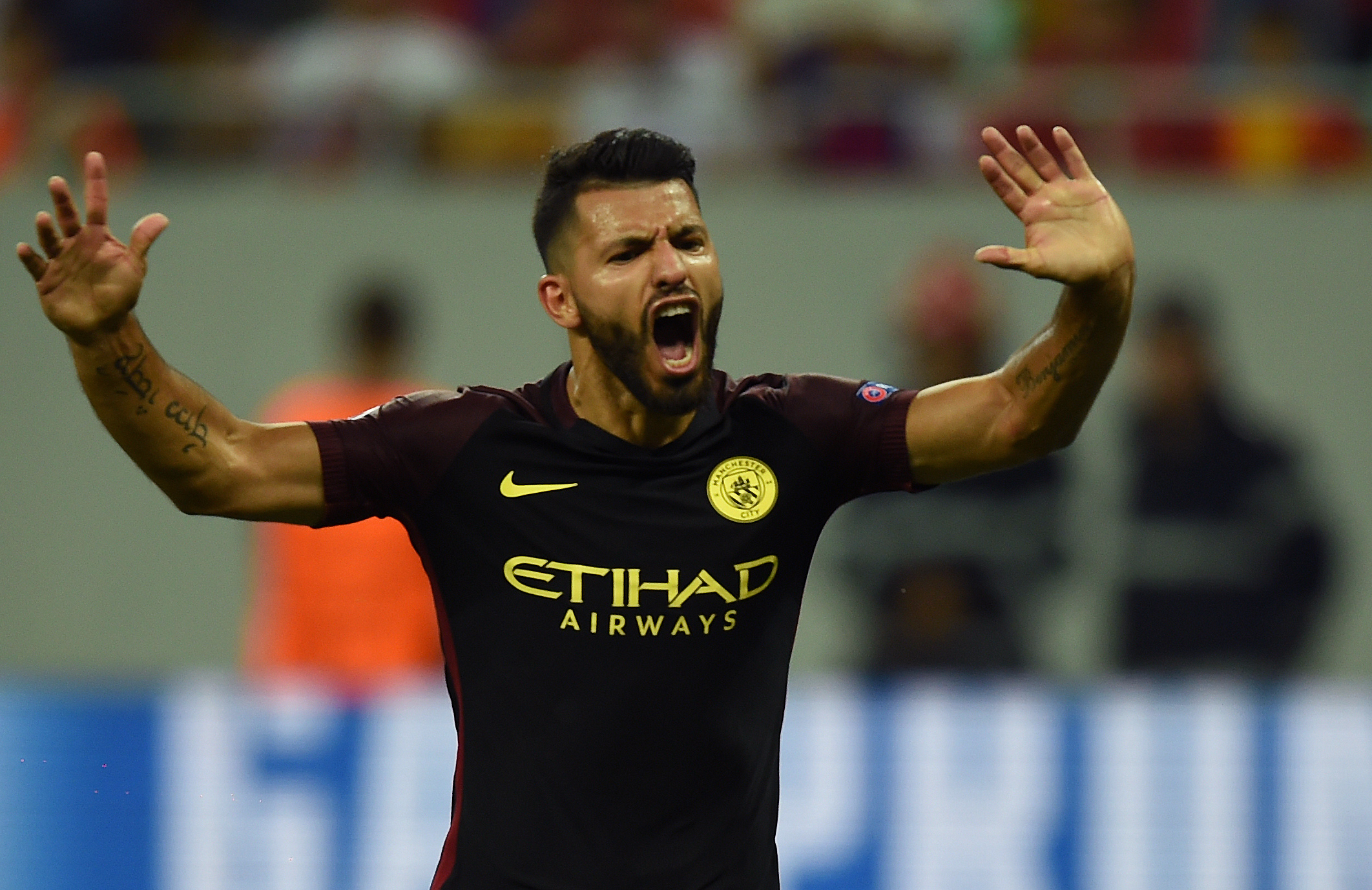 Manchester City's Argentinian striker Sergio Aguero celebrates scoring a goal during the UEFA Champions league first leg play-off football match between Steaua Bucharest and Manchester City at the National Arena stadium in Bucharest on August 16, 2016. / AFP / DANIEL MIHAILESCU (Photo credit should read DANIEL MIHAILESCU/AFP/Getty Images)