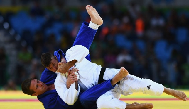 RIO DE JANEIRO, BRAZIL - AUGUST 08: Dirk van Tichelt of Belgium (blue) competes against Miklos Ungvari of Hungary in the Men's -73 kg Contest for Bronze Medal B on Day 3 of the Rio 2016 Olympic Games at Carioca Arena 2 on August 8, 2016 in Rio de Janeiro, Brazil. (Photo by David Ramos/Getty Images)