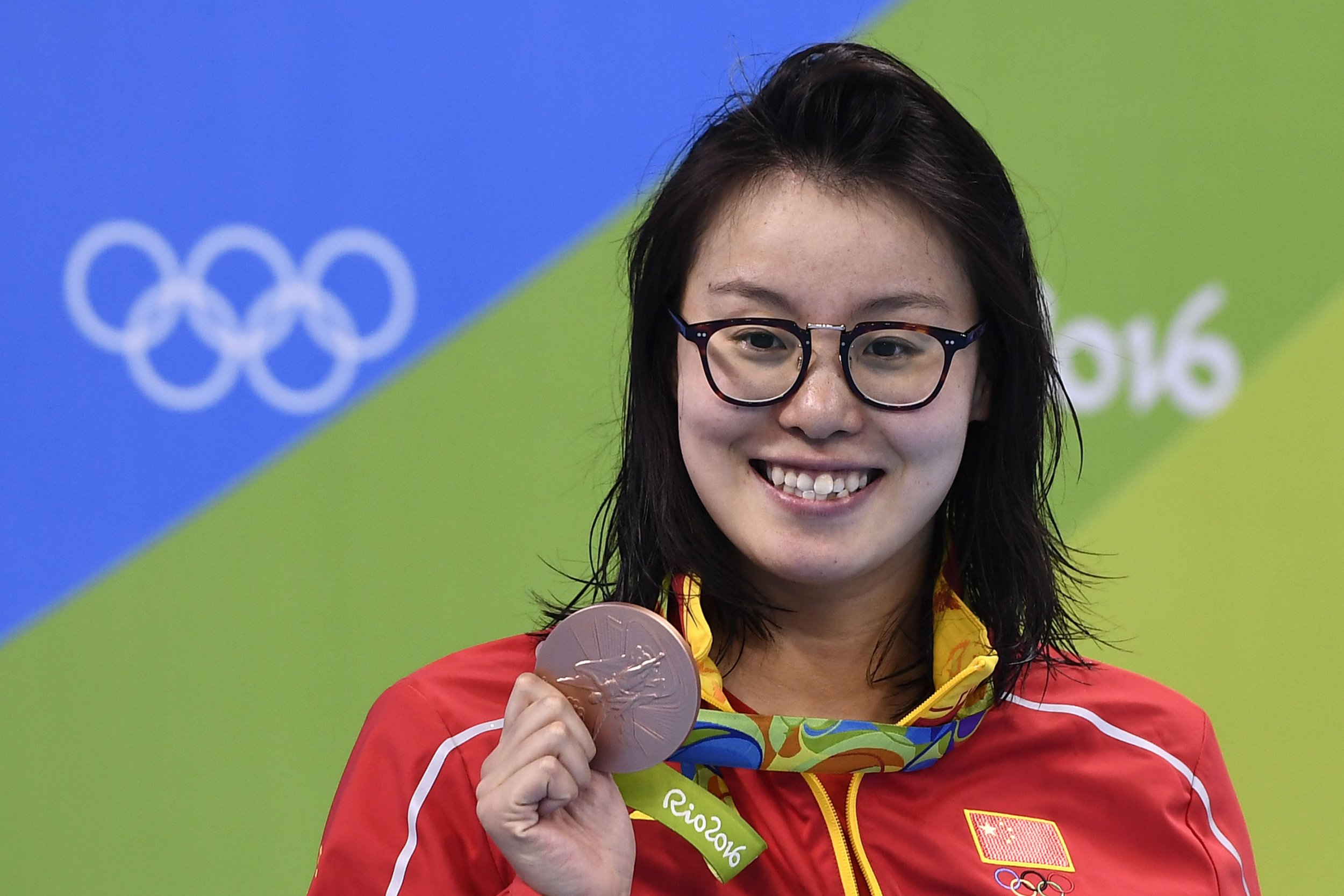 Japan's Fu Yuanhui poses with her bronze medal on the podium of the Women's 100m Backstroke during the swimming event at the Rio 2016 Olympic Games at the Olympic Aquatics Stadium in Rio de Janeiro on August 8, 2016. / AFP PHOTO / GABRIEL BOUYSGABRIEL BOUYS/AFP/Getty Images