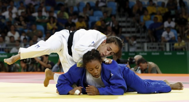 Israel's Gili Cohen (white) competes with Mauritius' Christianne Legentil during their women's -52kg judo contest match of the Rio 2016 Olympic Games in Rio de Janeiro on August 7, 2016. / AFP / Jack GUEZ (Photo credit should read JACK GUEZ/AFP/Getty Images)