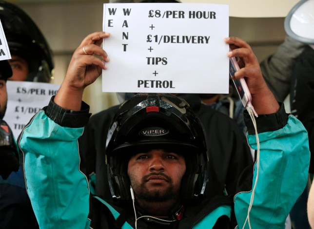 Deliveroo riders hold a protest over pay outside the company HQ in Torrington Place, London.