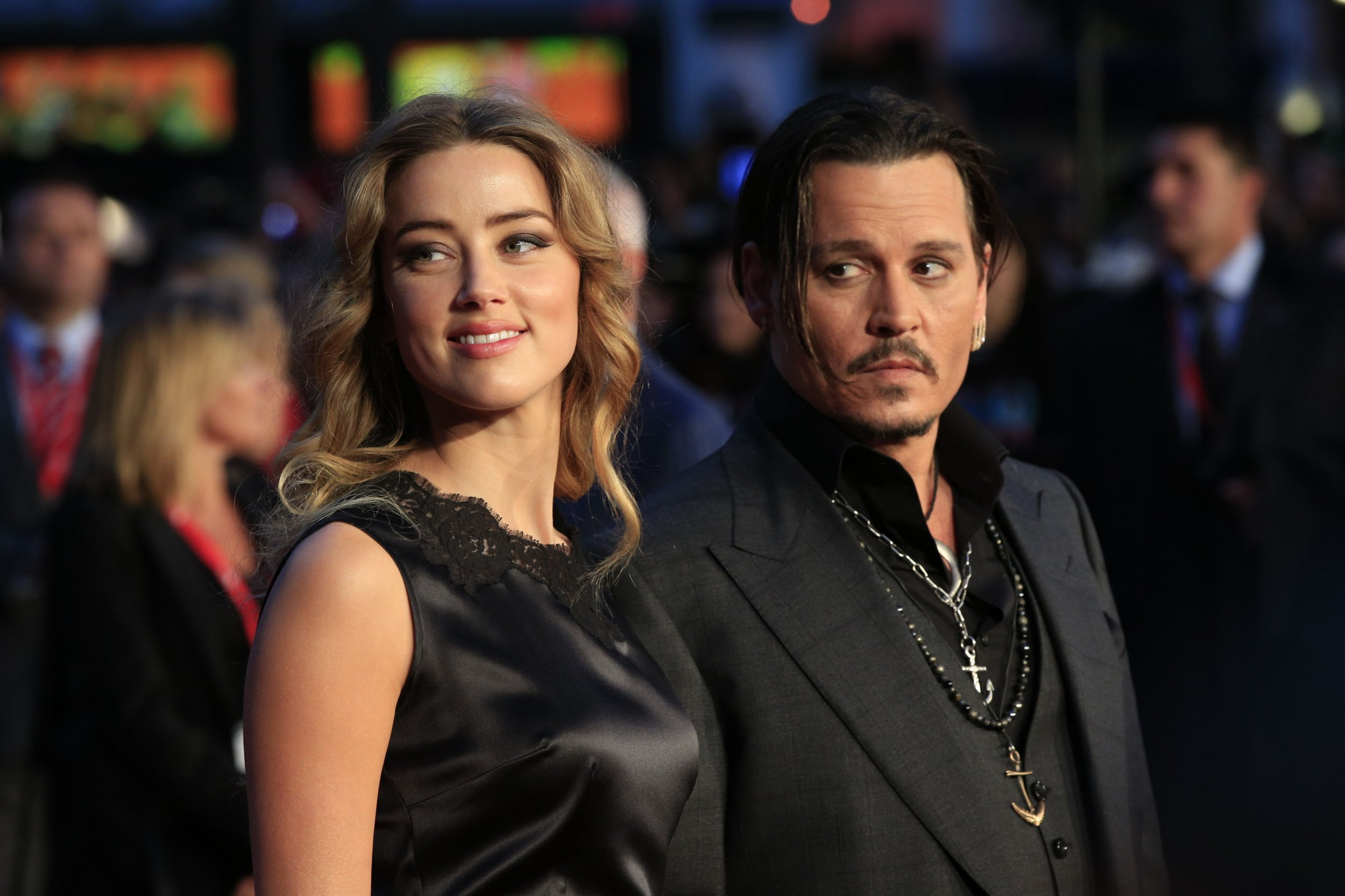 """File photo dated 11/10/15 of actor Johnny Depp and his estranged wife Amber Heard who has included a graphic photo of the actor's bloody finger in court documents after he allegedly cut off the tip by accident during a fit of rage. PRESS ASSOCIATION Photo. Issue date: Tuesday August 16, 2016. Depp, 53, also dipped his butchered finger in blue paint and wrote """"Starring Billy Bob Easy Amber"""" on a mirror, the papers in Heard's domestic abuse case against Depp reportedly claim. See PA story SHOWBIZ Depp. Photo credit should read: Jonathan Brady/PA Wire"""