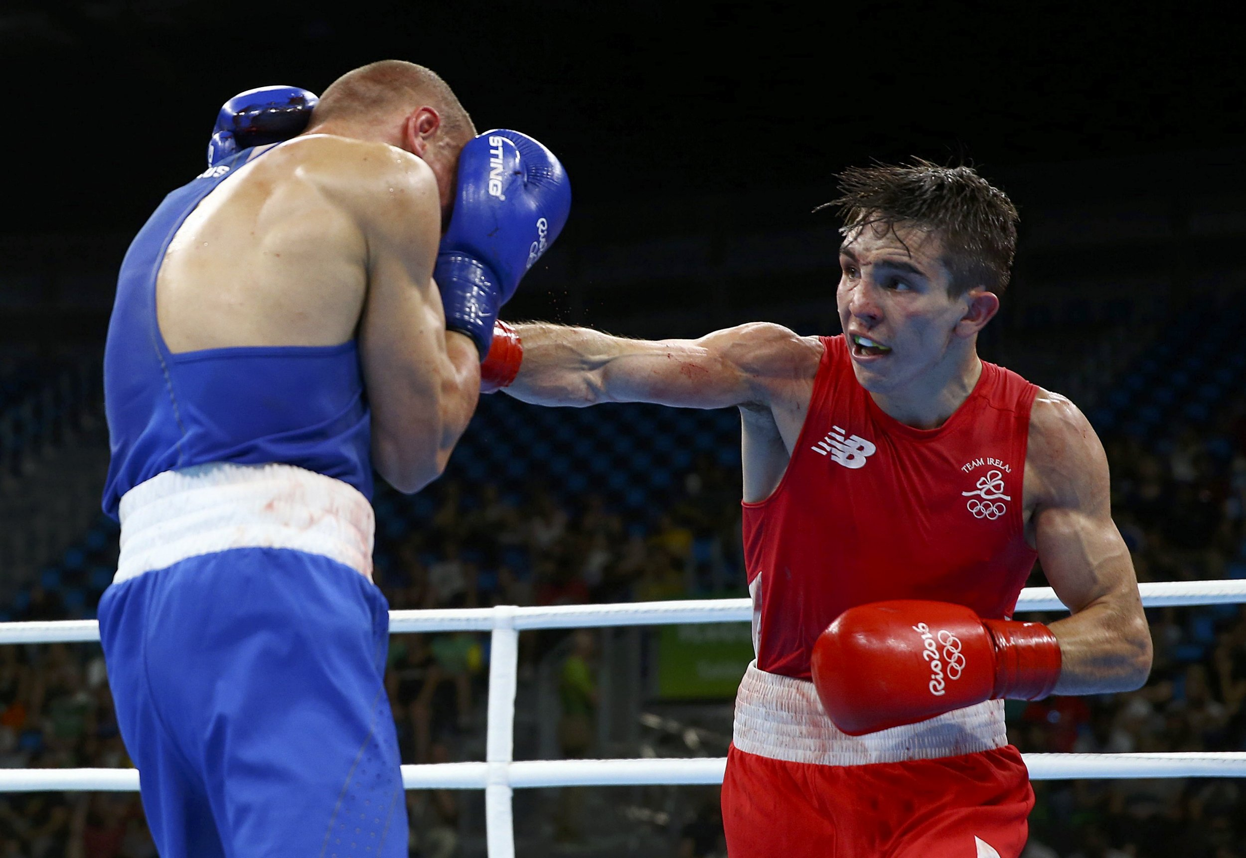 2016 Rio Olympics - Boxing - Quarterfinal - Men's Bantam (56kg) Quarterfinals Bout 223 - Riocentro - Pavilion 6 - Rio de Janeiro, Brazil - 16/08/2016. Michael Conlan (IRL) of Ireland and Vladimir Nikitin (RUS) of Russia compete. REUTERS/Peter Cziborra FOR EDITORIAL USE ONLY. NOT FOR SALE FOR MARKETING OR ADVERTISING CAMPAIGNS.