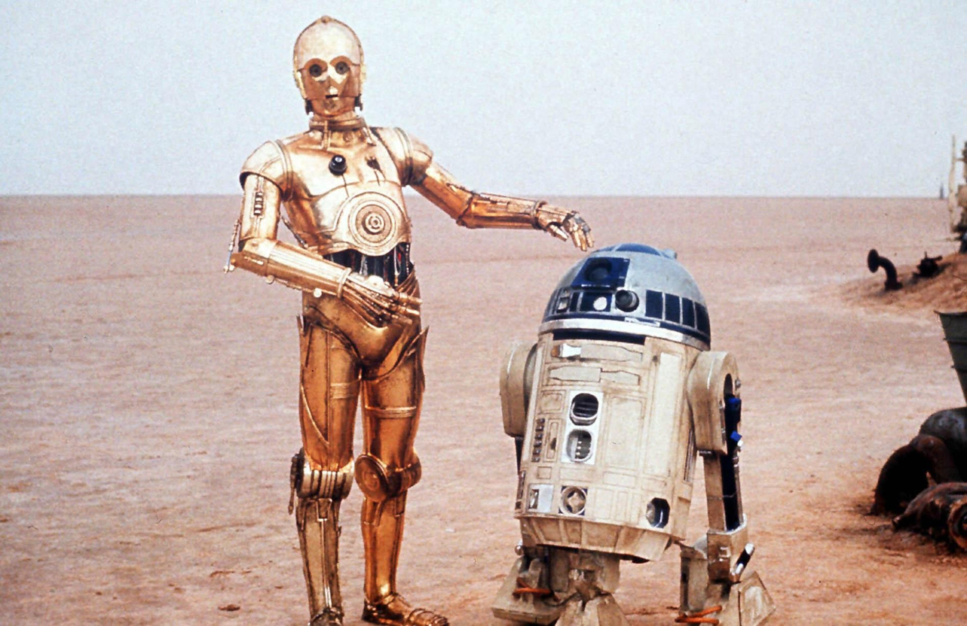Twentieth Century Fox undated handout photo of a scene from the film Star Wars showing C3PO and R2D2 (R) . Star Wars metal cutie R2D2 has been voted the world's favourite robot. Another robot from the 1977 film classic, worry-prone C3PO, also makes it into the top 15 poll, in fourth place for the poll for Amazon.co.uk and IMDB.com. See PA story SHOWBIZ Robots. PA Photo: Twentieth Centry Fox/Handout..A