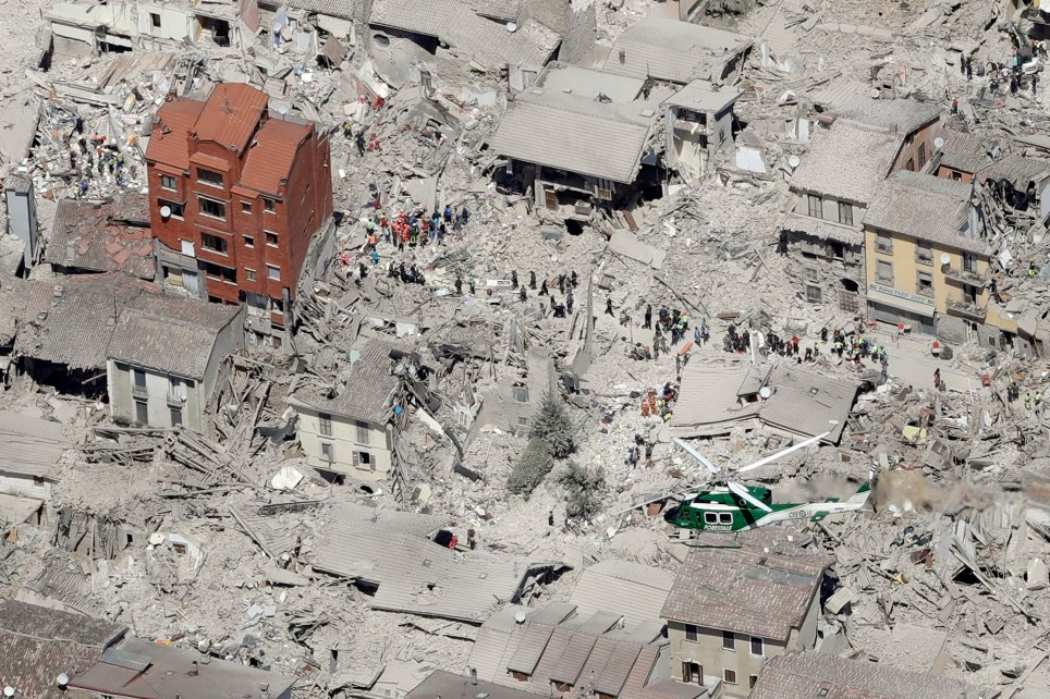 This aerial photo shows the damaged buildings in the historical part of the town of Amatrice, central Italy, after an earthquake, Wednesday, Aug. 24, 2016. The magnitude 6 quake struck at 3:36 a.m. (0136 GMT) and was felt across a broad swath of central Italy, including Rome where residents of the capital felt a long swaying followed by aftershocks. (AP Photo/Gregorio Borgia)