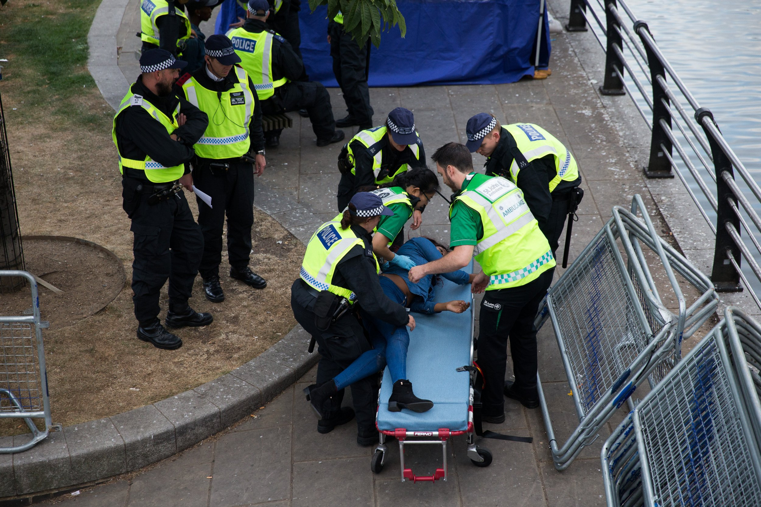 A woman is placed on a stretcher by Police Officers at Notting Hill Carnival, London. 28 August 2016.