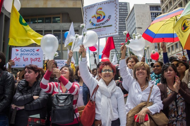 BOGOTA, COLOMBIA - JUNE 23 : People celebrate the signing of the ceasefire agreement between the Colombian government and the FARC guerrilla group in Bogota, Colombia, 23 June 2016. (Photo by Daniel Garzon/Anadolu Agency/Getty Images)