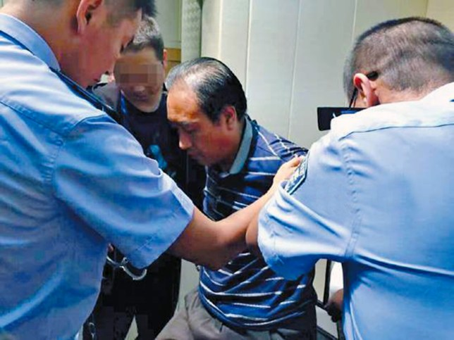 Pic shows: Gao Chengyong¿s arrested.nnA man wanted for raping and murdering almost a dozen girls and women - including an 8-year-old girl - has finally been caught after 28 years on the run.nnThe 52-year-old suspect named Gao Chengyong is said to have claimed his victims between 1988 and 2002, during which time he is believed to have killed no fewer than 11 people.nnGao, who allegedly committed most of his crimes in Baiyin City, in north-western China¿s Gansu Province, was finally arrested this week after police received a tip-off from a local resident who saw the suspect at the shops.nnThe alleged killer, a married father of two, admitted to the killings in Baiyin and Baotou, a city in neighbouring Inner Mongolia Autonomous Region, with his confessions officially bringing an end to a man hunt that lasted nearly three decades.nnBaiyin police first started looking for Gao when his first victim, a 23-year-old woman, was found murdered in her home in May 1988, having been stabbed 26 times.nnThe subsequent killings all followed a similar pattern, with the victims being girls or young women who lived alone.nnAccording to reports, the victims tended to dress in red and their bodies were found mutilated or in some cases even missing limbs.nnFollowing extensive investigations in Baiyin, China¿s Ministry of Public Security finally joined the case in 2001, collecting large amounts of fingerprints and other DNA evidence before announcing a 200,000 RMB (22,819 GBP) bounty for information as to the suspect¿s whereabouts.nnAccording to authorities, every single male permanent resident in Baiyin had their fingerprints tested by police, but none turned out to match the killer¿s.nnThis is because while Gao is thought to have mainly operated in the city, his household was registered in a village outside Gansu¿s provincial capital Lanzhou, where fingerprints were not required.nnHe lived between his village home and Baiyin City, but avoided any procedures that would require his fingerprints, successfully avoiding capture for 28 years.nnGao is now awaiting trial and faces 11 murder charges, each of which is punishable by a sentence ranging from 10 years¿ imprisonment to death, according to Chinese criminal law.nn(ends)