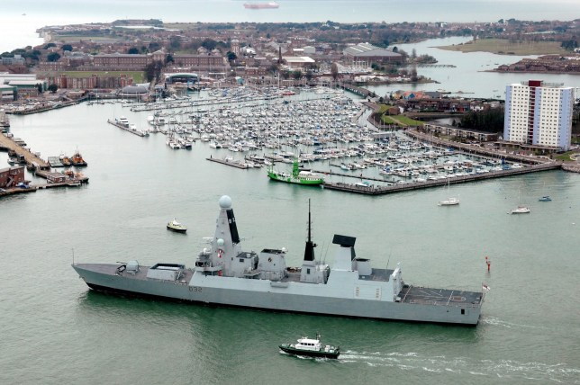 epa05513790 A handout photograph made available by the British Ministry of Defence (MOD) on 29 August 2016 showing British Royal Navy,Type 45 destroyer, HMS Daring leavinf Portsmouth harbour, southern England 01 February 2010. British Defence Secretary Michael Fallon stated on 29 August 2016 that HMS Daring is to be sent to the Gulf to support US carriers, give air cover, that are launching bombing raids on militants from the IS (Islamic State) group.  EPA/LA(Phot) IAN SIMPSON BRITISH MINISTRY OF DEFENCE / HANDOUT MANTATORY CREDIT MOD: CROWN COPYRIGHT HANDOUT EDITORIAL USE ONLY/NO SALES