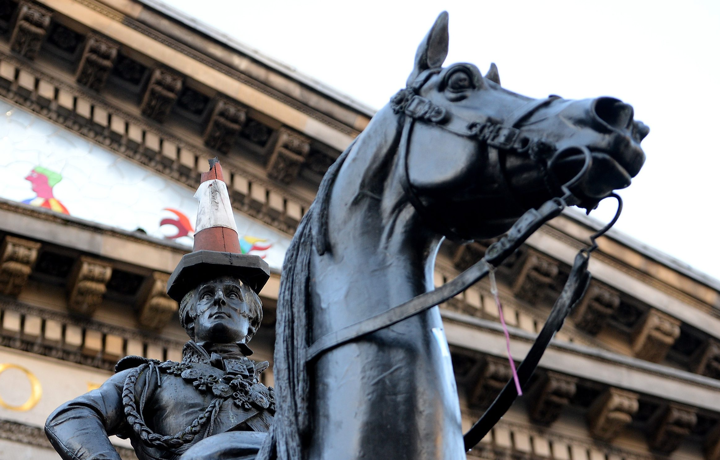 The Duke of Wellington Statue is pictured on November 18, 2013 in Glasgow, Scotland. Plans by Glasgow City Council to raise the plinth in an attempt to end the tradition of a traffic cone being placed on the statue have been abandoned due to a successful public campaign. More than 10,000 people had signed an online petition claiming that the cone on the head of the monument had become part of Glasgow's landscape. GLASGOW, SCOTLAND - NOVEMBER 18: (Photo by Jeff J Mitchell/Getty Images)