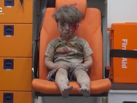Boy in the ambulance: Image of child pulled from rubble of Syria that shocked the world