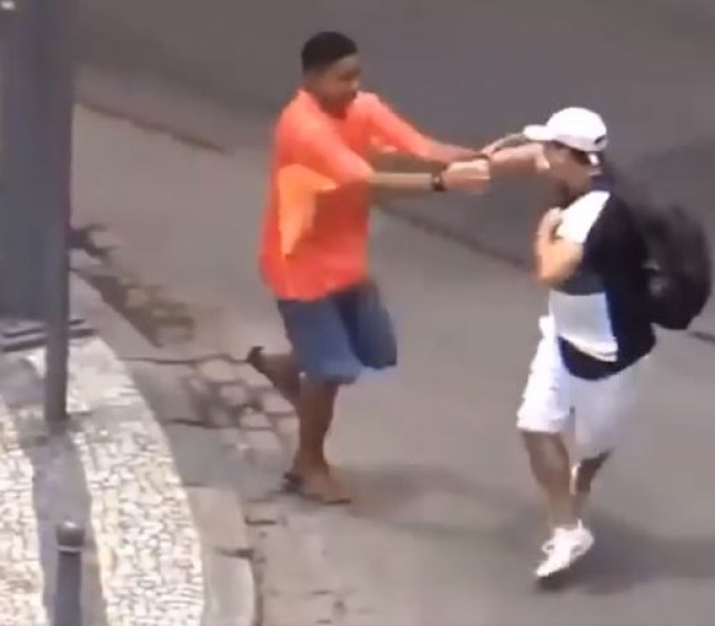 A youngster steals robs a pedestrian (Picture: Facebook)