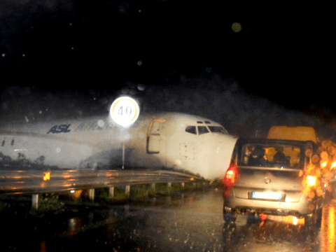Extraordinary escape as Boeing 737 skids off runway and smashes onto road