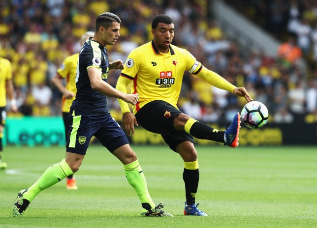 WATFORD, ENGLAND - AUGUST 27: Troy Deeney of Watford controls the ball infront of Granit Xhaka of Arsenal during the Premier League match between Watford and Arsenal at Vicarage Road on August 27, 2016 in Watford, England. (Photo by David Rogers/Getty Images)