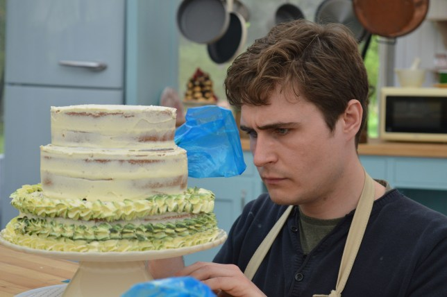 WARNING: Embargoed for publication until 21:00:01 on 21/09/2016 - Programme Name: The Great British Bake Off 2016 - TX: n/a - Episode: The Great British Bake Off 2016 - episode 6 (No. 6) - Picture Shows: Showstopper. Tom piping icing onto his cake **STRICT EMBARGO OF 2100 WEDNESDAY 21ST SEPTEMBER 2016** - (C) BBC - Photographer: Tom Graham
