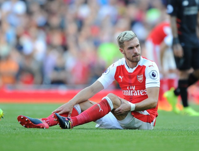 LONDON, ENGLAND - AUGUST 14: Arsenal's Aaron Ramsey injured during the Premier League match between Arsenal and Liverpool at Emirates Stadium on August 14, 2016 in London, England. (Photo by Stuart MacFarlane/Arsenal FC via Getty Images)