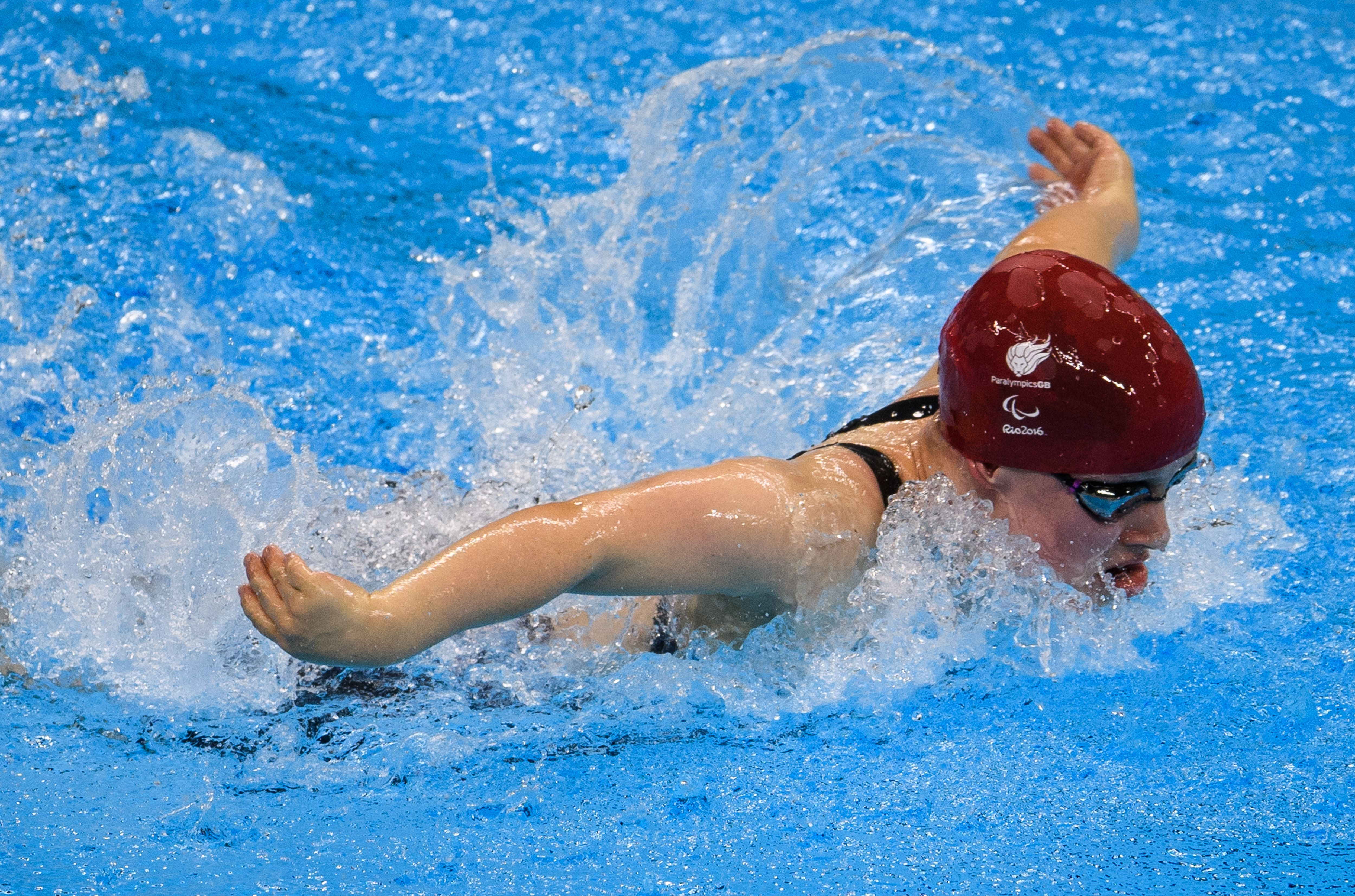 15-year-old Ellie Robinson wins gold for Team GB on Paralympic debut in the 50metres butterfly