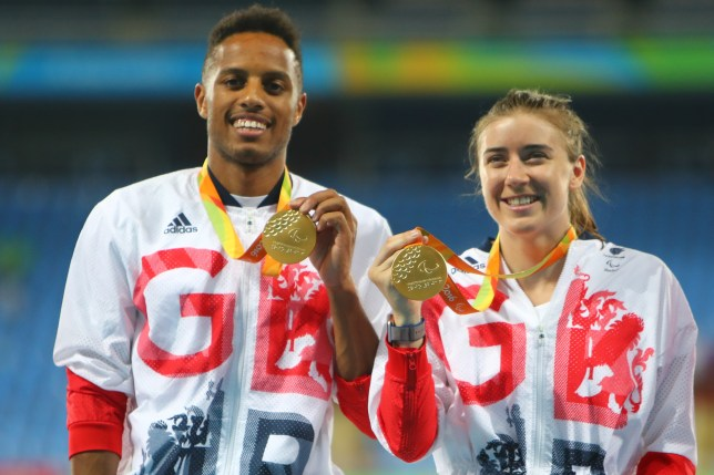 Gold medalist Libby Clegg of Great Britain and her guide Chris Clarke pose on the podium at the medal ceremony for women's 200m - T11 (Picture: Getty)