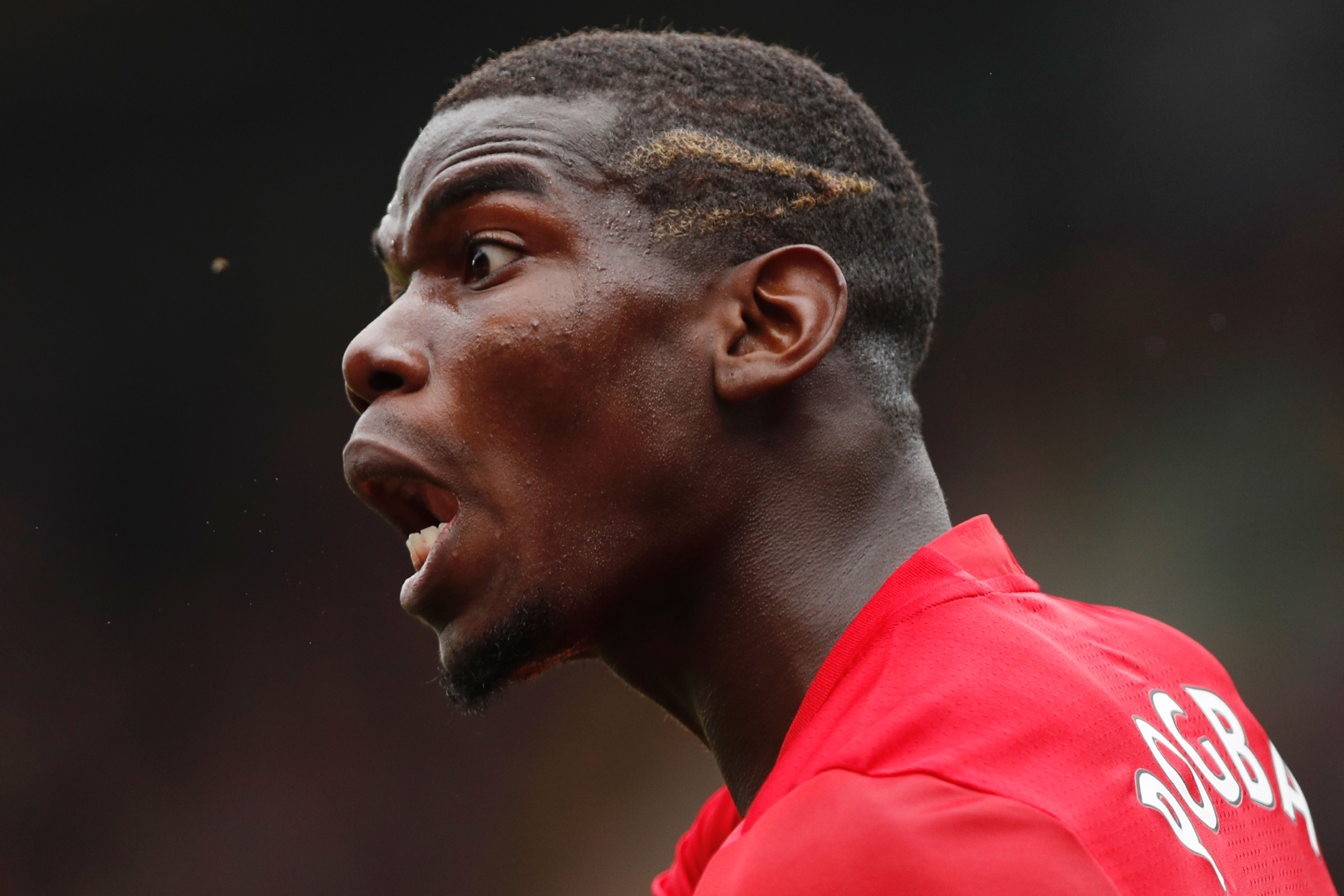 Manchester United's French midfielder Paul Pogba shouts at the linesman during the English Premier League football match between Watford and Manchester United at Vicarage Road Stadium in Watford, north of London on September 18, 2016. / AFP / Adrian DENNIS / RESTRICTED TO EDITORIAL USE. No use with unauthorized audio, video, data, fixture lists, club/league logos or 'live' services. Online in-match use limited to 75 images, no video emulation. No use in betting, games or single club/league/player publications. / (Photo credit should read ADRIAN DENNIS/AFP/Getty Images)