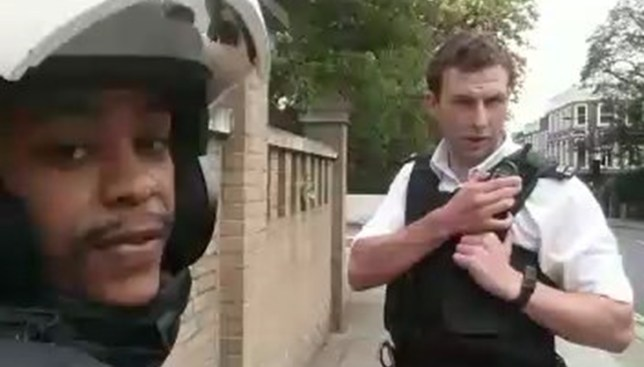 Video grab of 'PC Savage', harrasing Kyle Adair-Whyte, 24 two weeks before the officer was videoed smashing another black man's windscreen. See NATIONAL story NNSAVAGE. The video, which has gone viral with more than 25 million hits, shows an officer screaming at driver Leon Fontana to 'get out of the car' before smashing the windscreen with his baton and clearing the glass away with a pocket knife. The officer is now subject to an IPCC inquiry and has been put on restricted duties after it emerged Mr Fontana had a legal driving licence. But today another video has emerged which allegedly shows the same officer, identified as a PC Savage, 'harassing' another black man two weeks earlier. Kyle Adair-Whyte, 24, claims he was hand-cuffed and detained for half an hour on September 4 near Haverstock Hill north LOndon while PC Savage called for backup because he believed the scooter Kyle was pushing was stolen.
