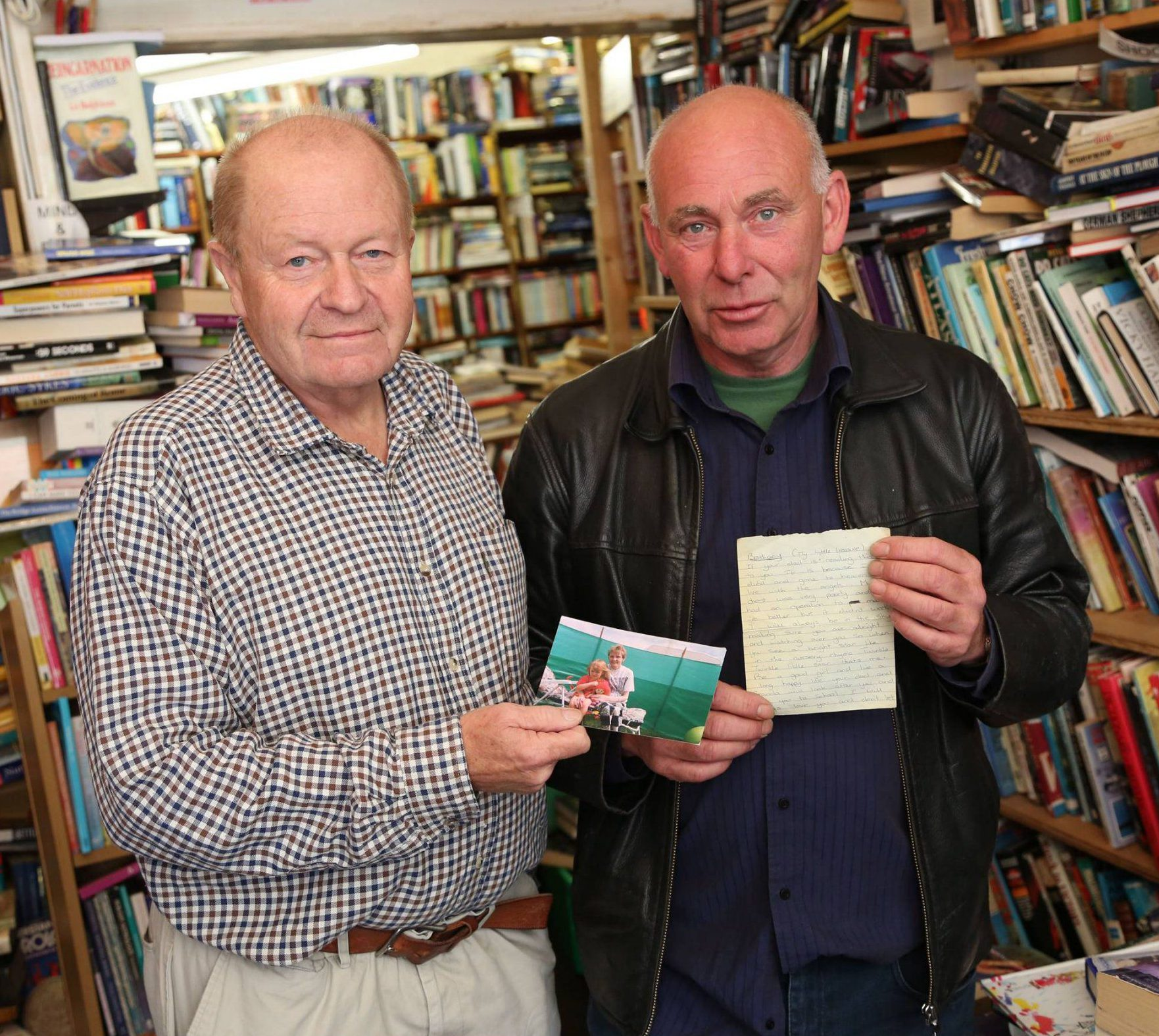 Dated 03/09/2016 Second-hand book shop owner Gordon Draper, from Bishop Auckland, County Durham, who discovered a heart-rending farewell letter from a dying mother in the pages of a book along with a photograph of the unknown woman with her daughter Bethany. Draper is now attempting to trace the family so he can return the precious memento. Pictured (right) with neighbouring shop owner Albert Mark, who is helping with the quest. See story North News NORTHERN ECHO COPYRIGHT - ONLY TO BE USED IN PRINTED EDITIONS - NOT TO BE USED ON-LINE WITHOUT FURTHER SPECIFIC PERMISSION AND LICENSE - IF USED WITHOUT PERMISSION THE NORTHERN ECHO RESERVE THE RIGHT TO TAKE LEGAL ACTION FOR BREACH OF COPYRIGHT AND DAMAGE TO BUSINESS