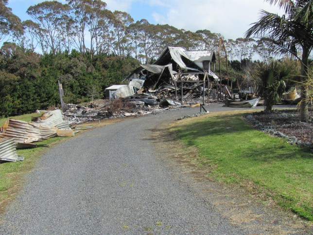 Destroyed: Killara lodge went up in flames at the weekend. / Chris Robinson, 68, accused of deliberately torching his own mansion / The home in Bay of Islands was burned to the ground in September 2011 / He is fighting Insurance Australia Group Limited over a £1.6million payout he is alleged to have rigged up a printer to torch his mansion by remote control from more than 260 miles away.