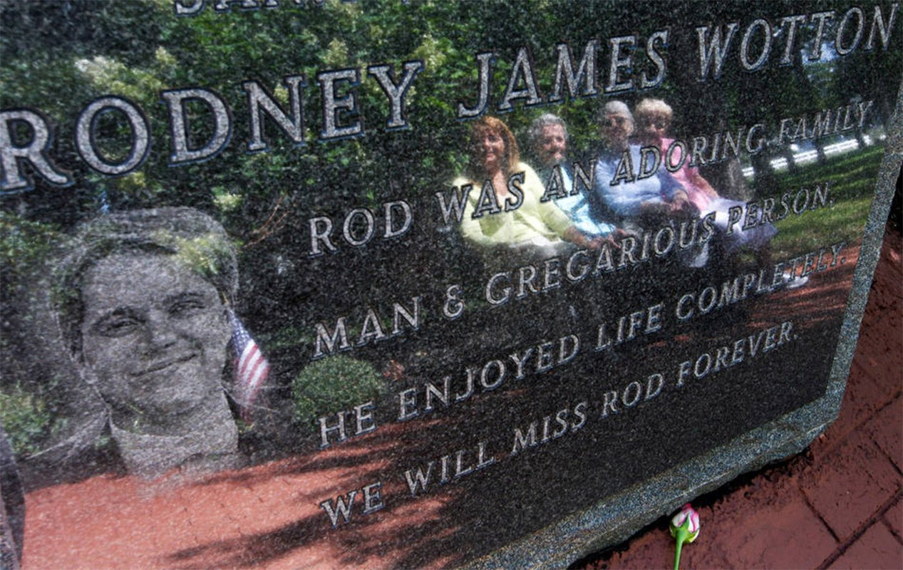 The 9/11 kids who never knew their dads Pat Wotton, left, is reflected Tuesday, Sept. 11, 2012, in Middletown, N.J., in a memorial to her husband Rodney James Wotton, as she sits with Dorothy Greene, second left, Jean Wotton, Rodney's mother, and Eunice Saporito, right. The marker for Rodney Wotton is one of 37 in the Middletown World Trade Center Memorial Gardens for those from the town in central New Jersey, who died in the attack on the World Trade Center in 2001. Americans paused again Tuesday to mark the 11th anniversary of the Sept. 11, 2001, terror attacks with familiar ceremony, but also a sense that it's time to move forward after a decade of remembrance.(AP Photo/Mel Evans)