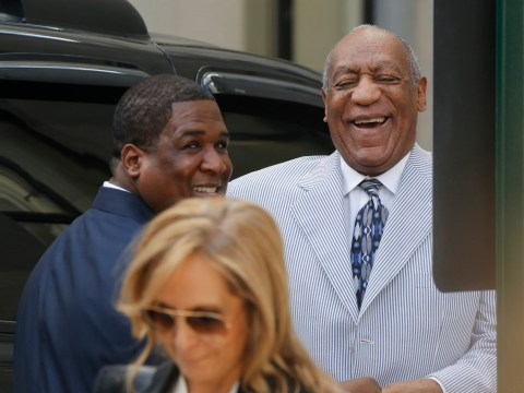 Bill Cosby laughing as he arrives at court for sex assault hearing