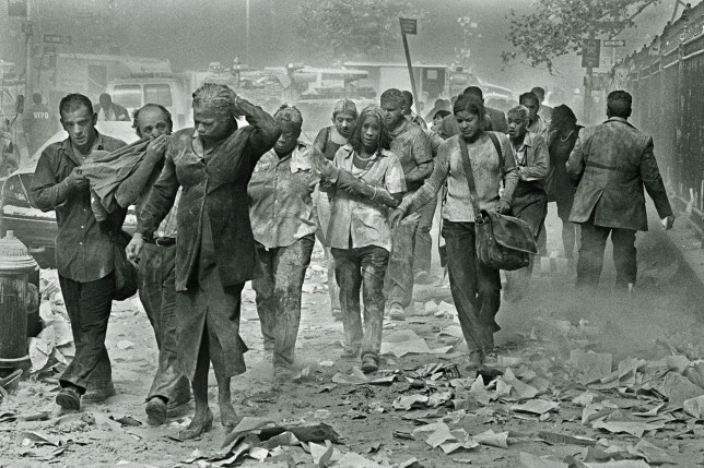 Mandatory Credit: Photo by ZUMA/REX/Shutterstock (4088781b)nPeople covered in ash make their way through dust and debris after the South Tower of the World Trade Center collapsed during Terrorist attacks in New York Tuesday.nSeptember the 11th, New York, America - 11 Sep 2001nn