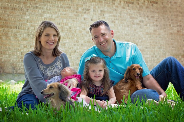 PICS BY DANIELLE HAYMES / CATERS NEWS - (PICTURED: Danielle, 39, Joe, 37, with Sandy the dog on the front with red long haired daschund Jeter, as well as Layna as a baby and other daughter Adelyn) - A canine-crazy couple have bought their dream five-bed home after making 14,000 (8,000) a year DOG SITTING in their spare time. Danielle and Joe Haymes, 39 and 37, from Houston in Texas, USA, started nearly three years ago and now rarely have a day where theyre not looking after other peoples dogs. They make up to 1,500 (,000) a month spending their free time with up to four pooches, along with their own long-haired dachshunds Sandy and Jeter. The couple say their part-time profession allows them to fill the void left from not being able to foster rescue dogs after having kids. After nearly three years of working for DogVacay they now have 50 repeat guests and make up to a whopping 8,000 a year. - SEE CATERS COPY