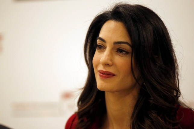 FILE - In this Jan. 25, 2016, file photo, British lawyer Amal Clooney attends a press conference with former Maldives president Mohamed Nasheed in London. Clooney is pushing for the United Nations to investigate and prosecute Islamic State commanders for genocide. Clooney wants IS leaders tried over the killings. The British lawyer appeared on NBCís ìTodayî show in an interview broadcast Monday, Sept. 19, 2016, alongside 23-year-old Nadia Murad, a Yazidi woman who escaped after being captured by IS in 2014. (AP Photo/Alastair Grant, File)